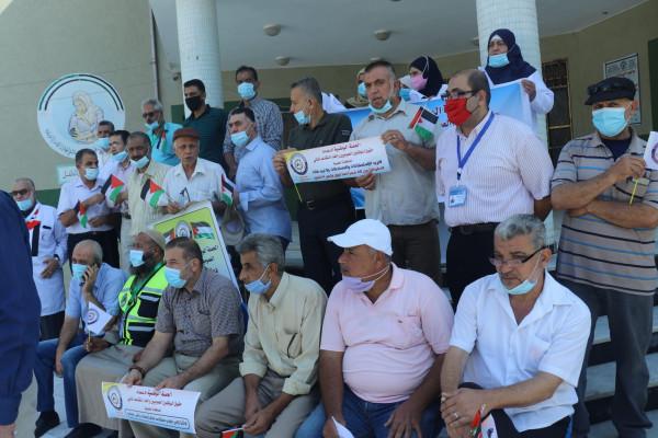 وقفات احتجاجية فى المستشفيات والمراكز الصحية بمحافظات غزة رفضاً للتقاعد المالي