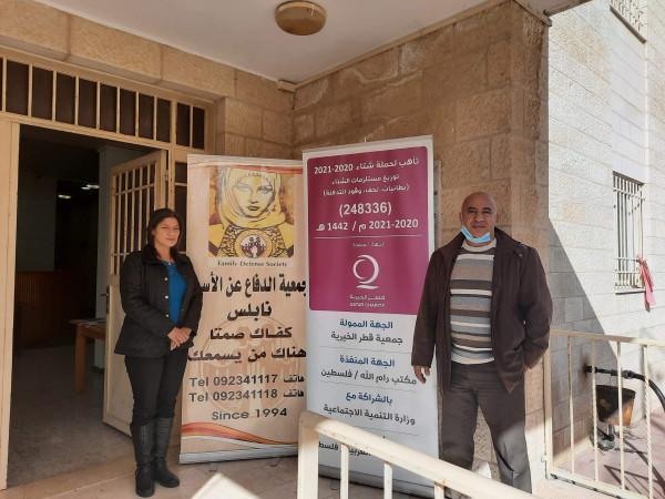 تنمية نابلس وقطر الخيرية توزعان 3000 لتر سولار للجمعيات الخيرية الايوائية