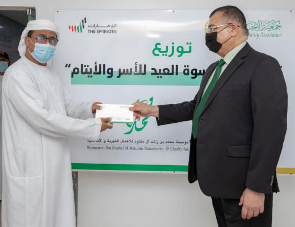 الإحسان الخيرية توزع كسوة عيد الأضحى بالتعاون مع مؤسسة محمد بن راشد آل مكتوم
