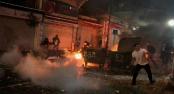 مواجهات في باب حطة وسلوان وشبان يحرقون أعمدة لكاميرات المراقبة