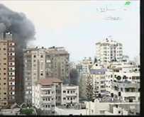 شاهد اول فيديو لتدمير 14 طابقا من برج الظافر في مدينة غزة