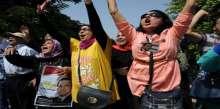 إحتشاد المؤيدين للرئيس السابق مبارك أمام بوابة المحكمة