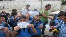 الهيئة الفلسطينية للتنمية ومؤسسة أمان فلسطين –ماليزيا توزع جداول مدرسية