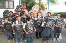 المشروبات الوطنية كوكاكولا/كابي توزع اكثر من 5000 حقيبة مدرسية