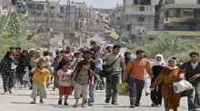 توزيع مساعدات إغاثية في مخيم نهر البارد