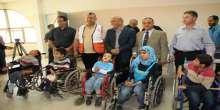 الهلال الأحمر الفلسطيني والمستشفى الأردني يقدمون مساعدات لأطفال الشلل الدماغي