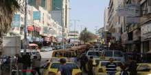 مسيرة لسيارات النقل العمومي في الخليل تضامن مع مخيم اليرموك