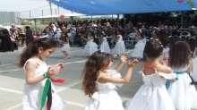 قوات الأمن الوطني الفلسطيني تشارك في حضور حفل اليوم المفتوح وتكريم الطلبة الأوائل الذي أقامته مدرسة بنات الطيبة