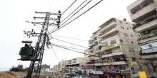 """""""كهرباء القدس"""" تحول خط الضغط العالي في شارع عناتا الرئيسي في مخيم شعفاط الى كوابل أرضية"""