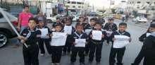 بالصور: مجموعة كشافة ومرشدات الشهيد ياسر عرفات تحيي يوم العمال العالمي باستعراض كشفي