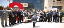 بنك القدس يسلم الفائزة الطفلة من بلدة بيت ريما سيارة أوبل كورسا 2015 والفائزة من بيت لاهيا راتب بقيمة 500 دولار