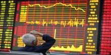 الصين: صحفي يعترف  بانه تسبب بفوضى الاسواق المالية