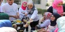"""كلية فلسطين الاهلية الجامعية وجمعية العائلة السكرية تنفذان فعالية """" تفاحتك بأيدك"""""""