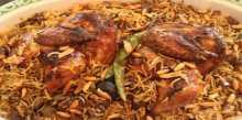 بالفيديو .. طريقة عمل كبسة الدجاج السريعة من مطبخ منال العالم
