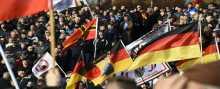 الأوروبيون في مظاهرة يطالبون باستقالة ميركل