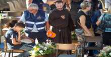Italy holds state funeral for 35 of earthquake's victims